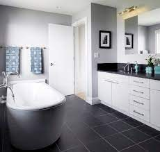 How To Use Dark Floors To Brighten Your Dull Home Black Bathroom Floor Dark Gray Bathroom Gray And White Bathroom