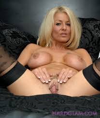Mature Blonde MILF Tia Layne with Plump Pussy Wearing Stockings.