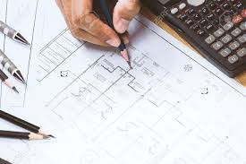 office desk plan. Close-up Of Person Engineer Hand Drawing Plan On Blue Print With Architect Instrument At Office Desk N