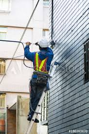 Cable Installation Job Professional Engineers In The High Rise Wall Installation