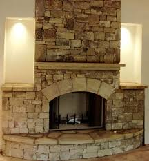 this stacked stone fireplace is made of all natural stones