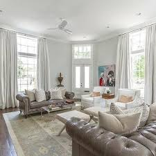 gray leather chesterfield sofas with gray zebra pillows
