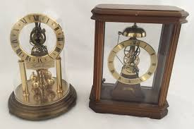 lot 1097 2 quartz clocks a rapport with wooden case together with a kundo