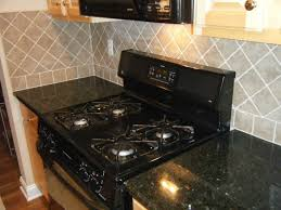 black granite countertops with tile backsplash. Black Granite Countertop Image. Wonderful Ceramic Tile Designs For Kitchen Backsplashes : Natural Diagonal Backsplash Design Classy Countertops With E