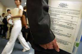 useless buzzwords you shouldn t use on a resume in  a man holds his buzzword heavy resume at a job fair