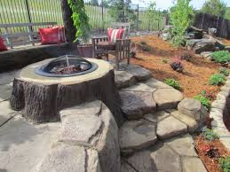 awesome concrete fire pit ideas like stones added wooden seating also iron fencing in backyard garden designs