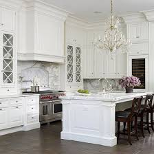 it will feature white marble soapstone polished chrome white cabinets an antique cast iron farmhouse sink and a sparking vintage crystal chandelier