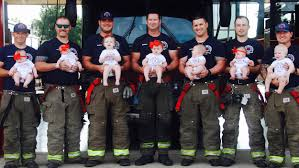 7 firefighter dads pose with new babies in adorable photo shoot