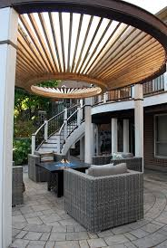 Catio outdoor cat enclosures. Curves, curves, curves! A funky design with a  curved upper deck & staircase