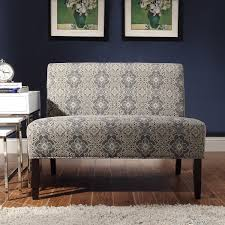 This elegant gray armless loveseat fits perfectly in a small space.  Featuring a fine floral