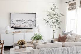 White coastal living room with lots of personality. Simple Tv Wall Decor Living Room Update Caitlin Marie Design