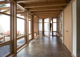 poured concrete floors modern hall also concrete floor entrance entry entry bench exposed beams frosted glass glass wall minimal neutral colors wood ceiling