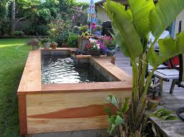 Small Picture Small fish pond wood layered Backyard design ideas Pinterest