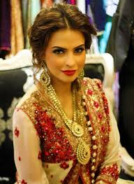 necklace and earrings the makeup is cly but playful definately perfect indian wedding