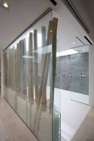 this electric glass screen can turn opaque at the touch of a on bamboo trunks screen a freestanding tub on the other side