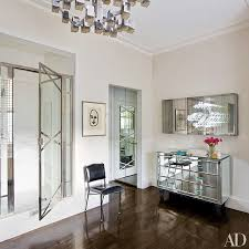 area mirror tables for living room. designer veere grenney placed a neon-and-mirror work by brigitte kowanz above area mirror tables for living room