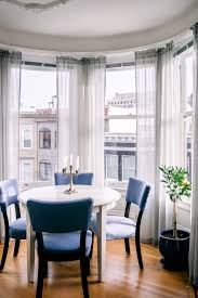 Turret Room Design Turret Dining Area With White Table Blue Chairs And French