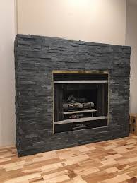 stacked-stone-fireplace-in-progress