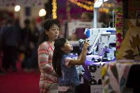 Thousands attend International Quilt Festival at the Brown ... & Emily Deng, 8, experiments with a swing machine at the International Quilt  Festival Houston Adamdwight.com