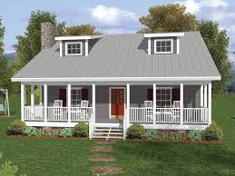 one and a half story home with deep covered porch and twin dormers