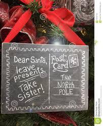 Christmas Signs Funny Christmas Signs To Santa Take Sister Stock Photo Image