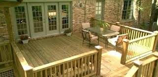 cost of concrete patio vs wood deck how to add a deck patio or outdoor kitchen your home homeowner wood wooden ideas home wood deck patio cost of concrete