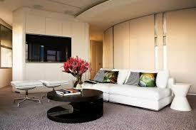 living room set up ideas white sofa round coffee table black carpet