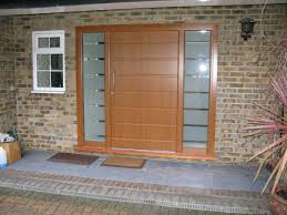 single wooden front doors with frosted glass panels for house design with exposed brick wall and mounted lamp plus window with white wooden frame ideas