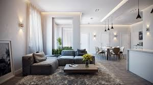 casual looking apartment living room design with white wall color and dark grey bed sofa also square wooden coffee table idea