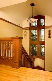 prairie style staircase with chunky newel post lighting arts crafts window bannister