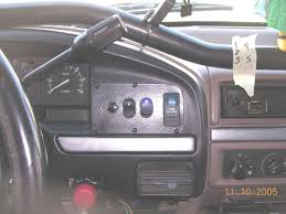 in cab winch wiring for warn 9000i and new switch panels ford from left to right is the 3 position momentary winch controller up is in middle is off and down is out the winch arming switch the york on switch and