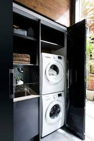 black washer and dryer. Black Closet Laundry Room With White Stacked Washer And Dryer