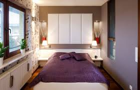 Collect this idea photo of small bedroom design and decorating idea -  purple and plants