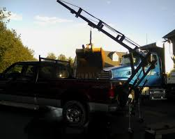 Loaderack, is a hitch mounted ladder rack that is also a crane.