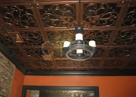 sagging tin ceiling tiles bathroom: antique copper faux tin ceiling tiles plus pretty chandelier and white wall for ceiling decoration ideas
