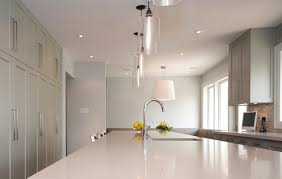 white kitchen island lighting idea with multi clear glass shade pendant lamps