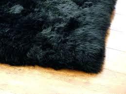 black faux fur rug black fur rug against light hardwood floor large black round faux fur