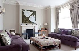 furnitures beauty living room with fl upholstered coffee table near purple sofa ans white fireplace