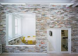 office interiors magazine. Oktavilla\u0027s Colorful Office Wall Is Made Of Stacked Recycled Magazines Office Interiors Magazine O