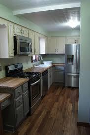 kitchen dark wood flooring and beadboard backsplash idea dark wood floor kitchen designs