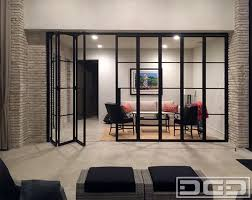 panoramic accordion door in bronze finished steel and clear glass