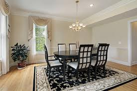 black and white dining table set: formal dining room with very light beige walls white ceiling and trim and light wood