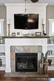 shiplap fireplace with reclaimed wood mantle and built ins theuniquenest com