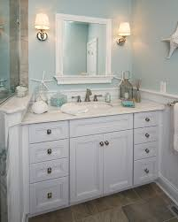 beachy decor bathroom beach style with wall lighting floor tile wood cabinets