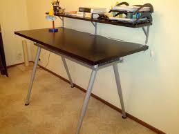 2 separate assemblies: shelf w/ L brackets, then regular standing desk