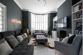 living room with dark blueish grey walls stylish dark grey furniture and huge window