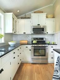 white cabinet dark kitchen black countertops cupboards with cabinets and