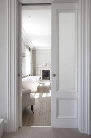 white house with pocket sliding door ways to fix stuck doors in