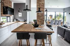 this living room dining area and kitchen was designed open plan but the area are