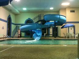 mansion with indoor pool with slides.  Pool Howard Johnson By Wyndham Billings Indoor Pool And Water Slide Inside Mansion With Pool Slides L